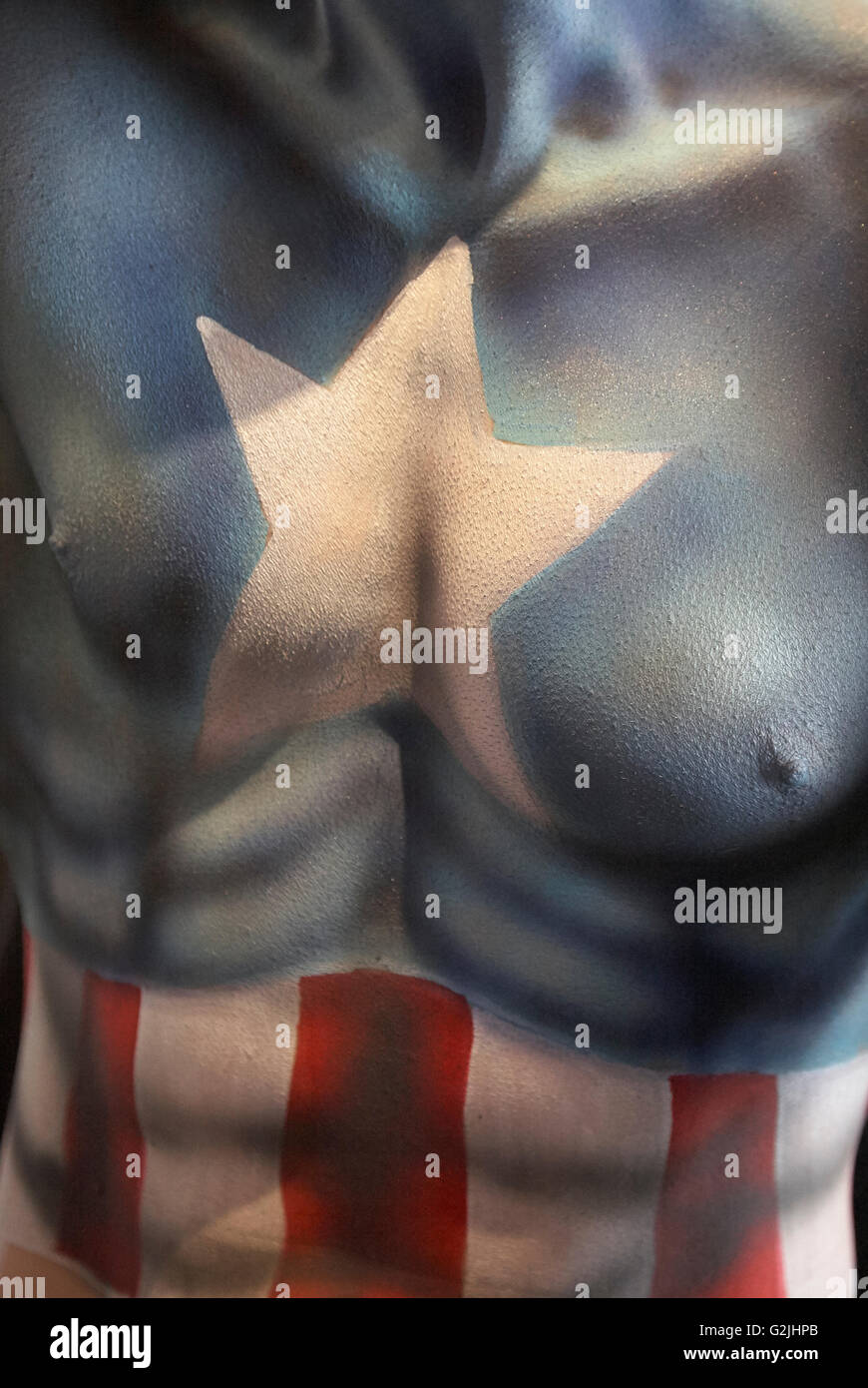 Body paint of Captain America on a man - Stock Image