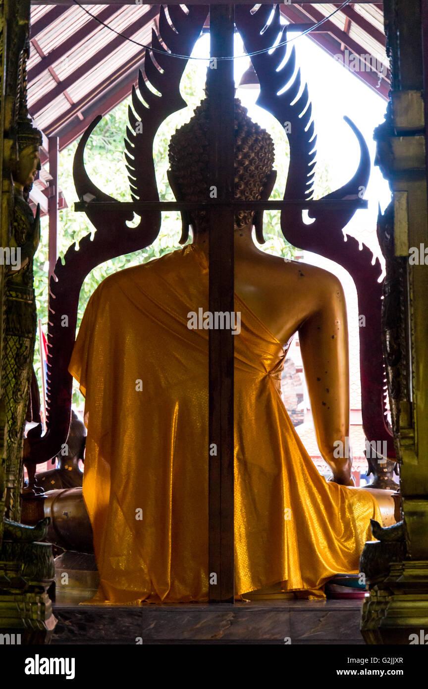 Rear View of Ayuthaya Seated Buddha Statue With Gilded Robe - Stock Image