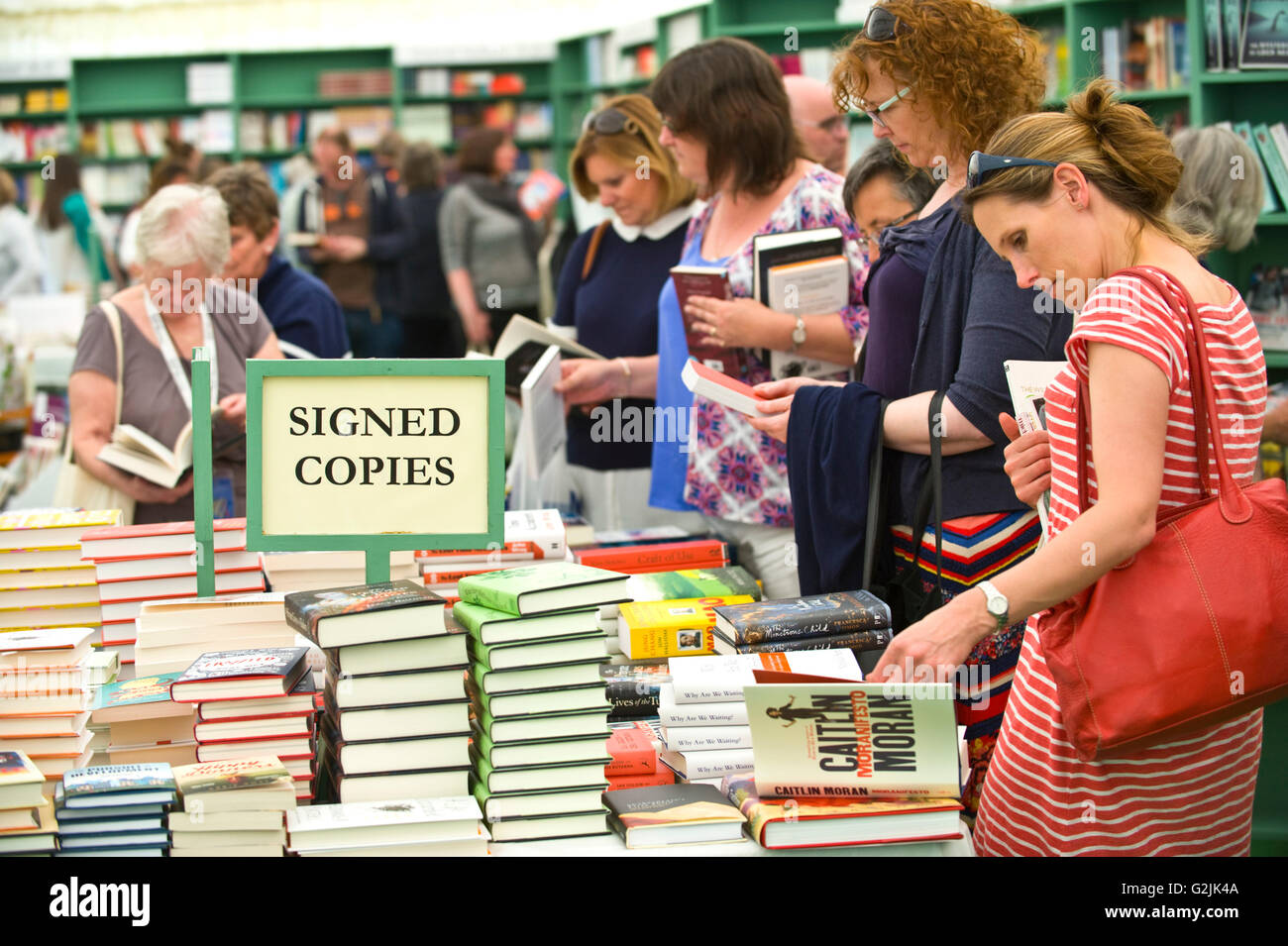 Women browsing author signed copies of books in the bookshop at Hay Festival 2016 - Stock Image