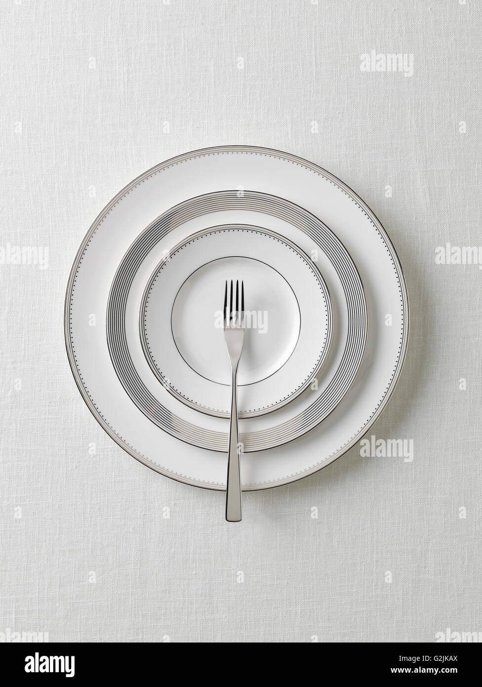 White Plates With Fork - Stock Image