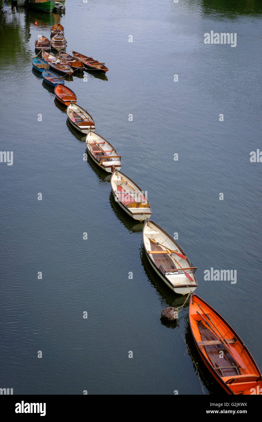 Moored rowing boats ,River Thames at Richmond Upon Thames,Greater London,England - Stock Image