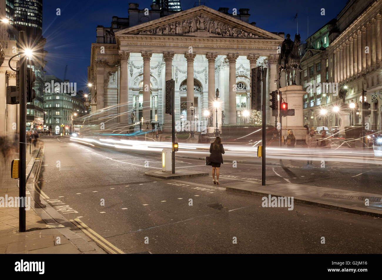 City of London,The Royal Exchange-business woman waiting on red light - Stock Image