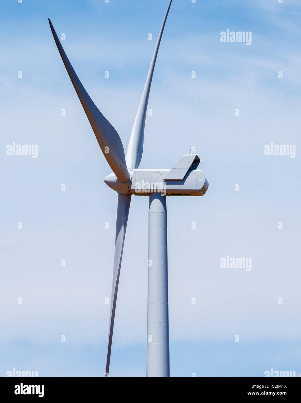 Close up view of a wind turbine against a blue and cloudy sky in Oklahoma, USA. - Stock Image