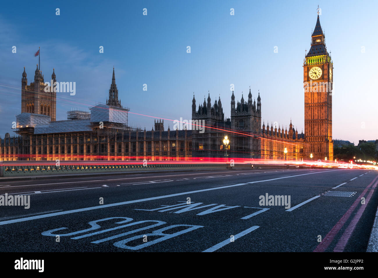 Houses of Parliament, Big Ben and Westminster Bridge in London at night - Stock Image
