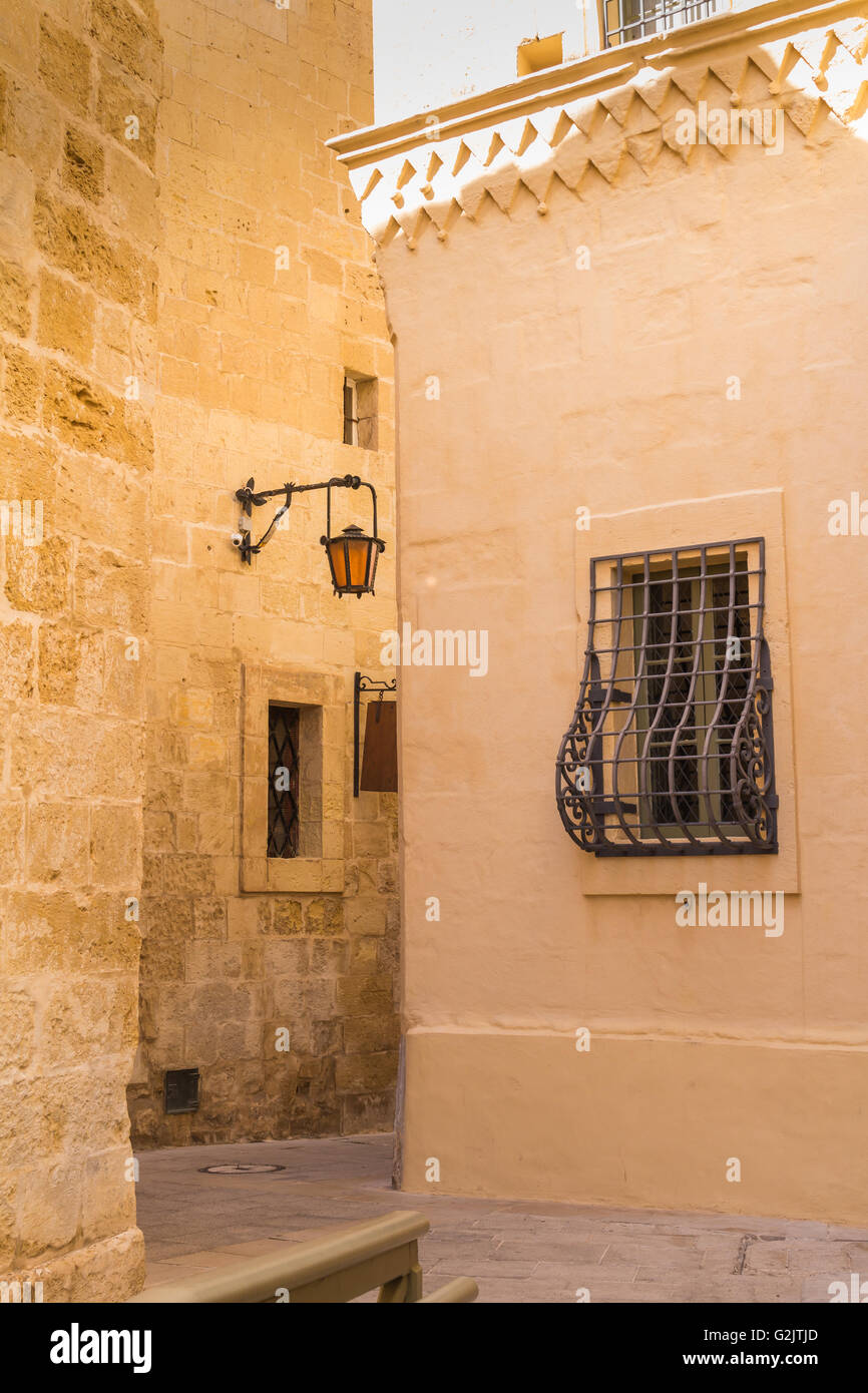 Fusion of arabian and baroque architecture in the former capital of island Malta - Mdina, medieval fortress. Stone - Stock Image