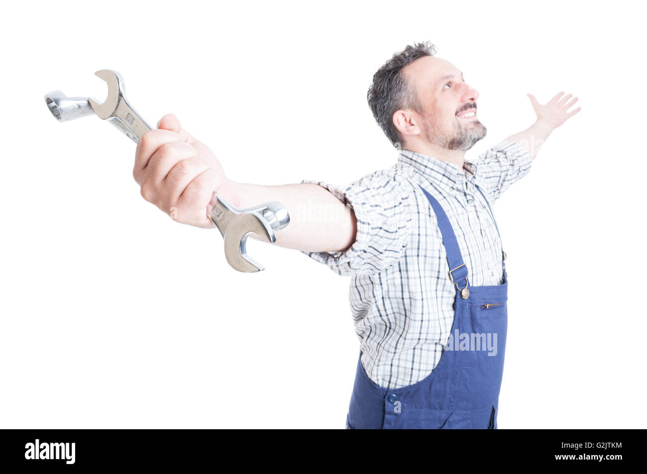 Positive feelings with happy mechanic enjoying his achievement as freedom concept isolated on white background - Stock Image