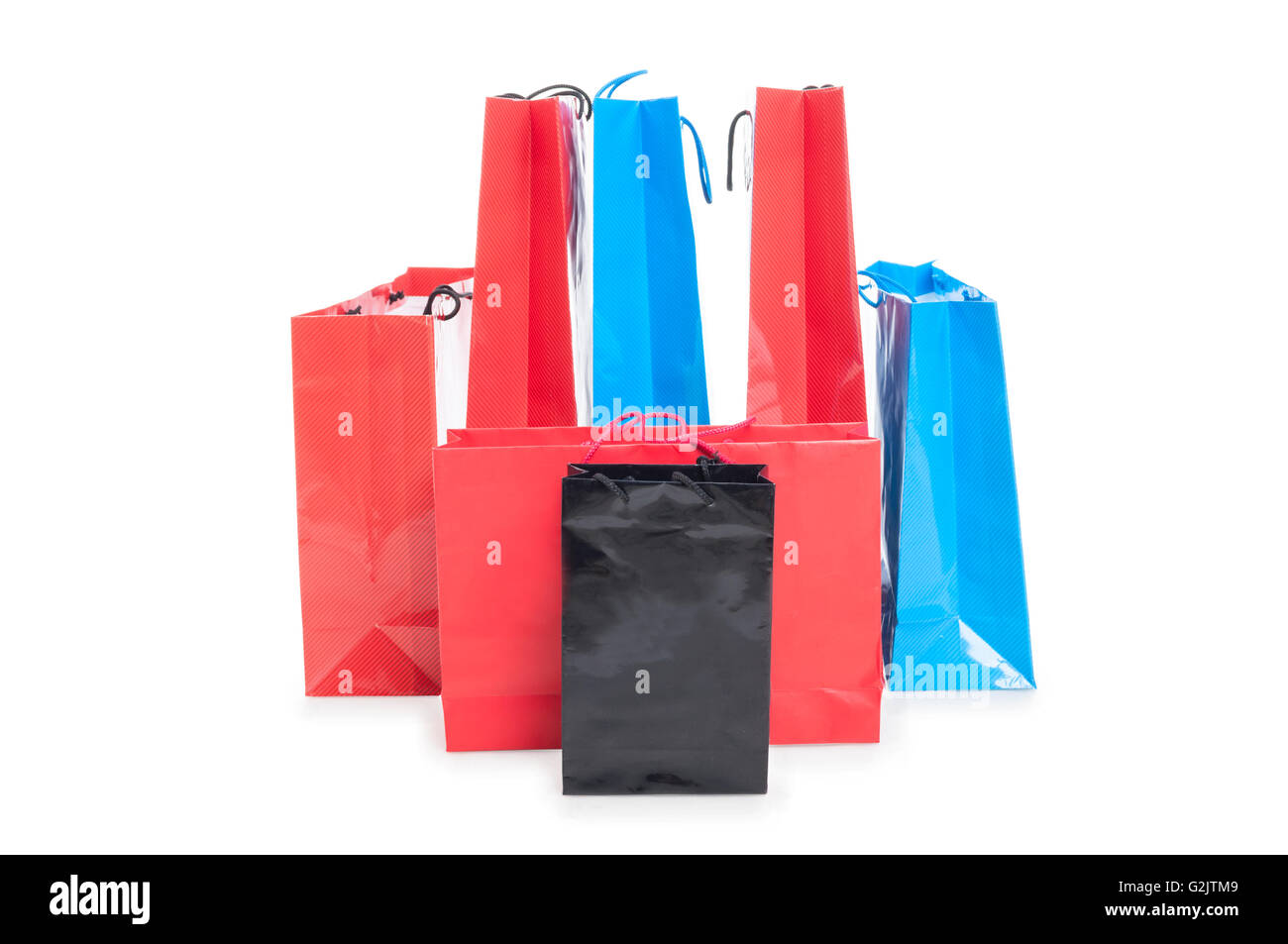 Assorted colored shopping bags included red, blue and black on a white background with copyspace - Stock Image