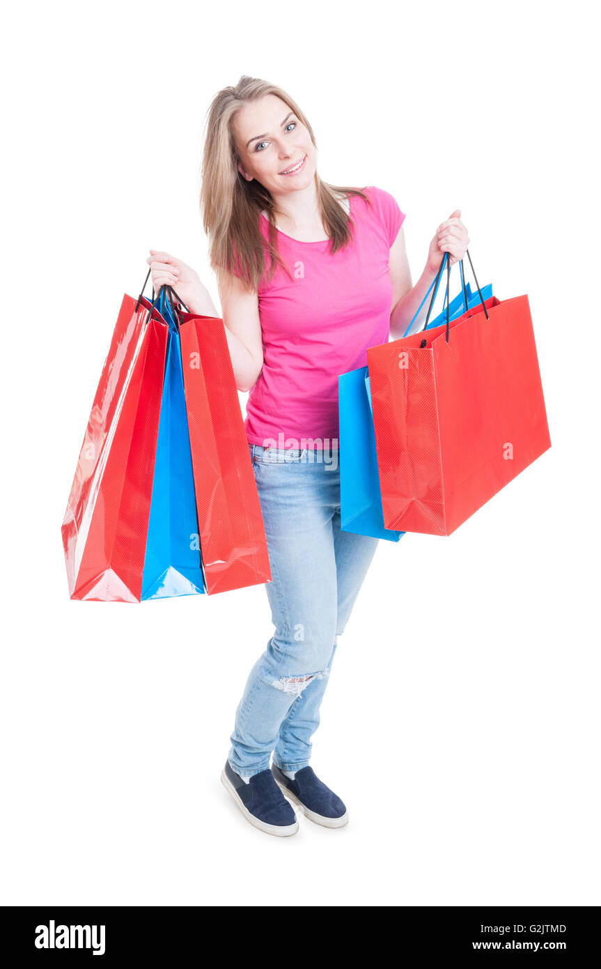 Happy beautiful woman holding and rising shopping bags and smiling isolated on white background - Stock Image