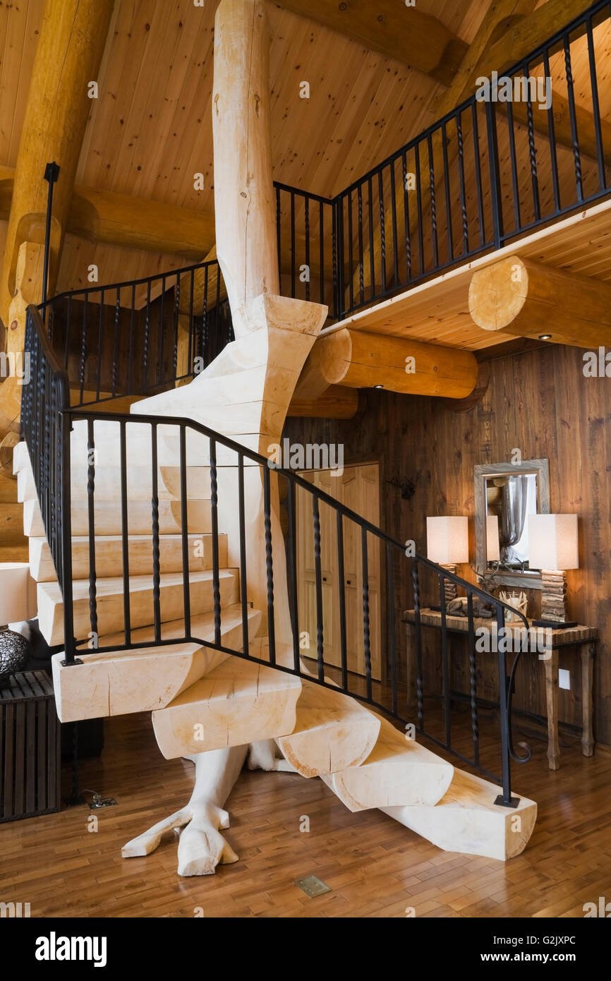 Bleached Wooden Stairs Black Wrought Iron Railing In Living Room Inside A  Luxurious Cottage Style Log Home Quebec Canada This