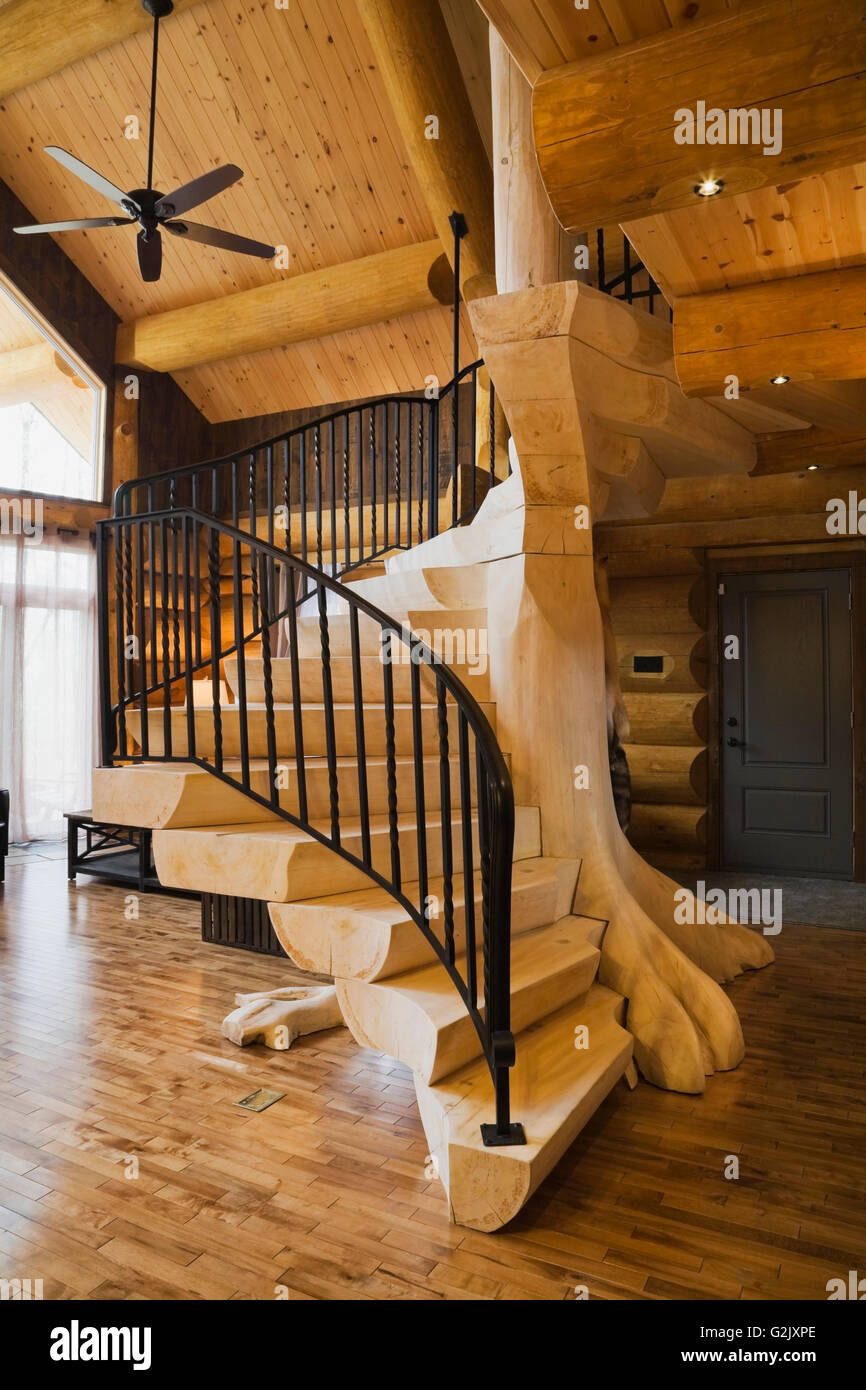 Bleached Wooden Stairs Black Wrought Iron Railing In