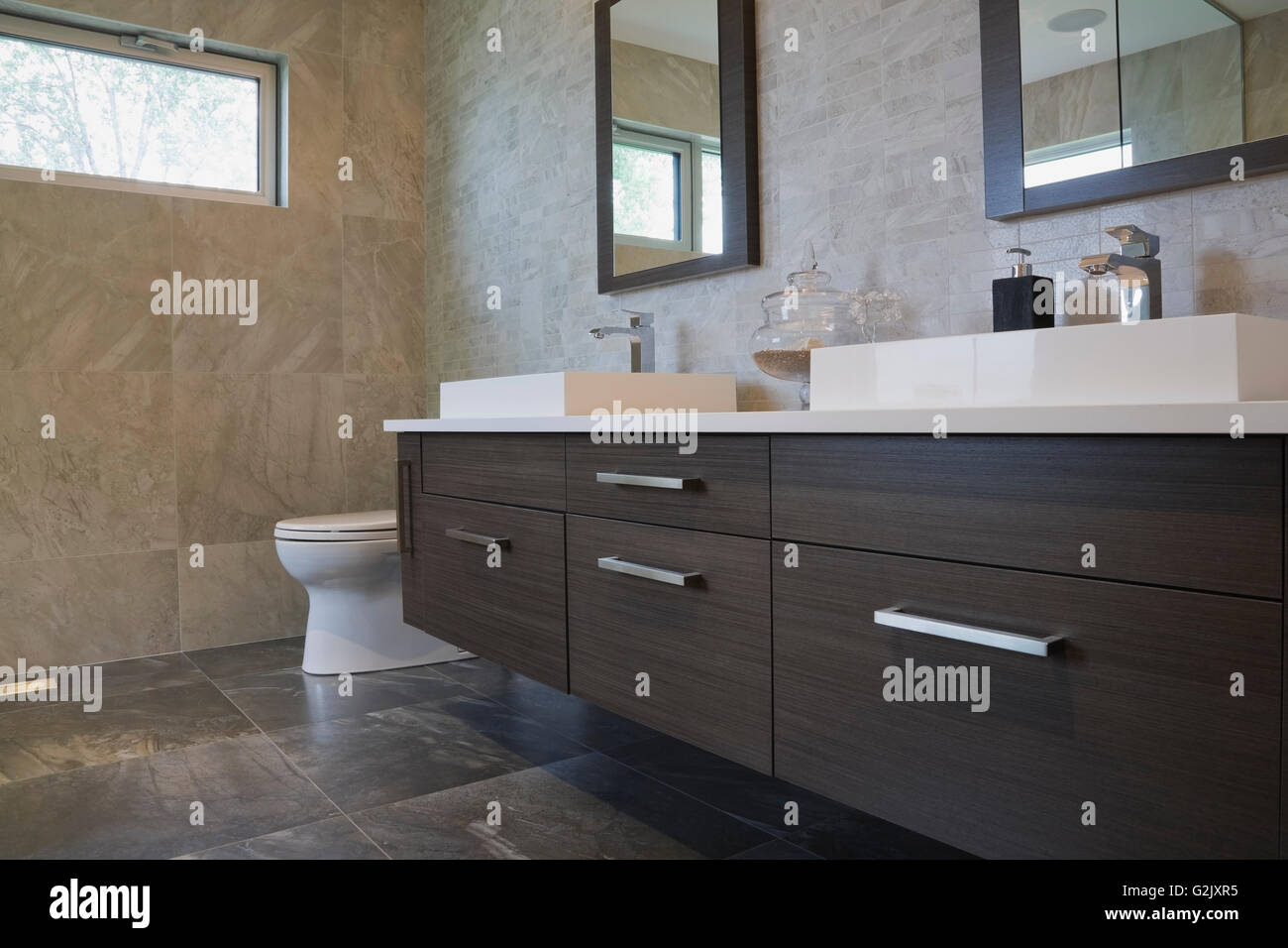 White rectangular porcelain sinks charcoal wooden vanity in a Stock ...