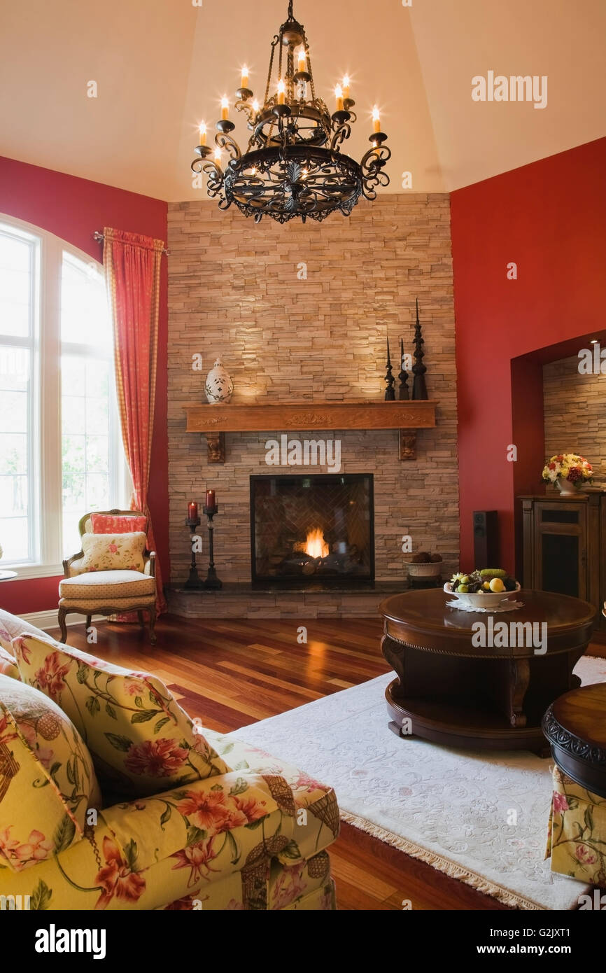 Excellent Living Room Flowery Upholstered Sofa Chair Lit Gas Fireplace Interior Design Ideas Truasarkarijobsexamcom