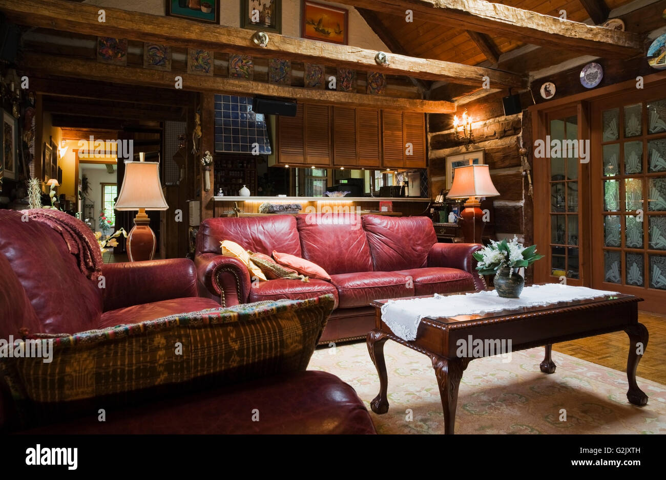 Wooden Coffee Table Burgundy Leather Sofa In Living Room French Doors  Inside A 1976 Reconstructed Cottage Style Log Home Quebec