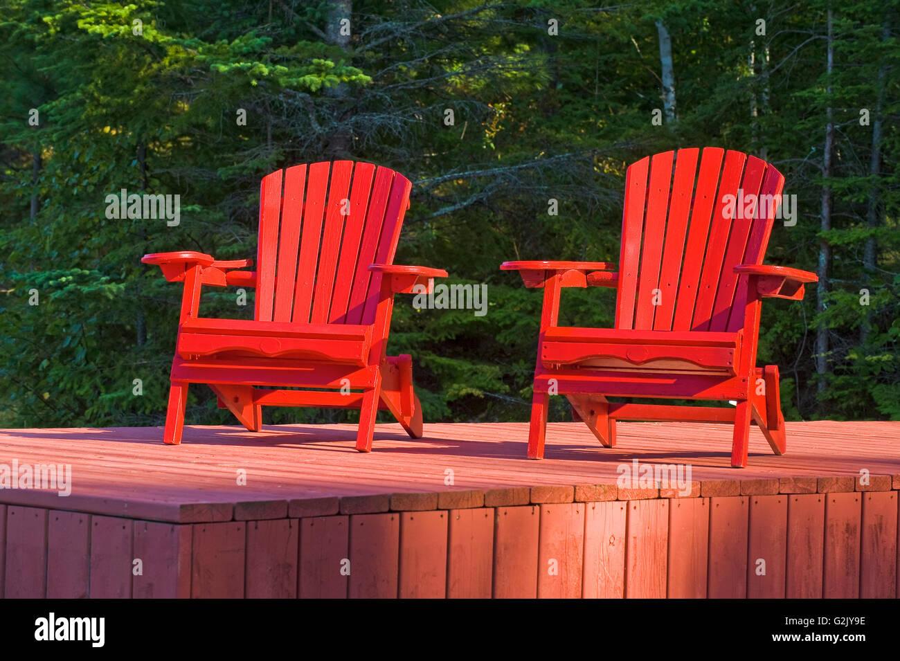 Muskoka chairs on dock, Lake of the Woods, Northwestern Ontario, Canada - Stock Image