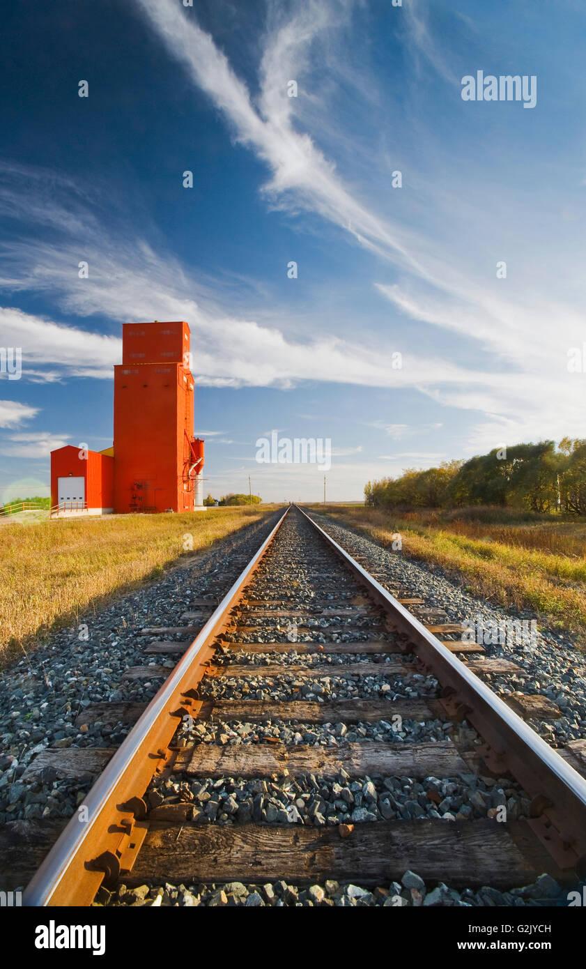old grain elevator and railway tracks, Carey, Manitoba, Canada - Stock Image