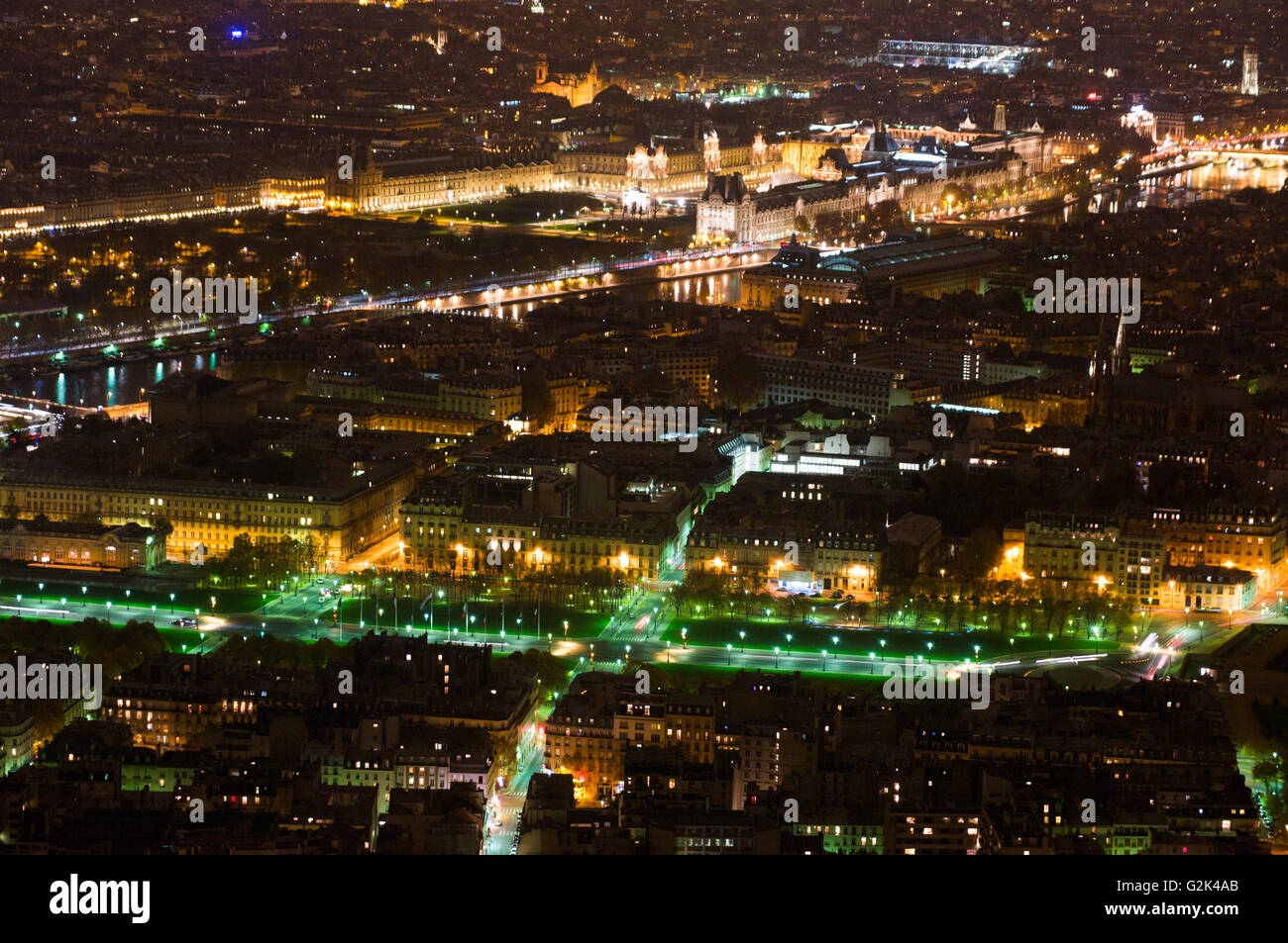 Aerial Night view of Paris City and Seine river shot on the top of Eiffel Tower Stock Photo