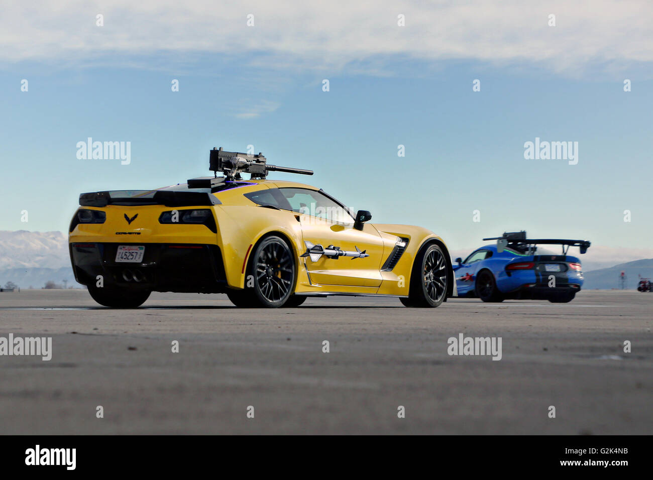 A Dodge Viper ACR and a Chevrolet Corvette Z06 rigged with prop weapons participate in a simulated dog fight during - Stock Image