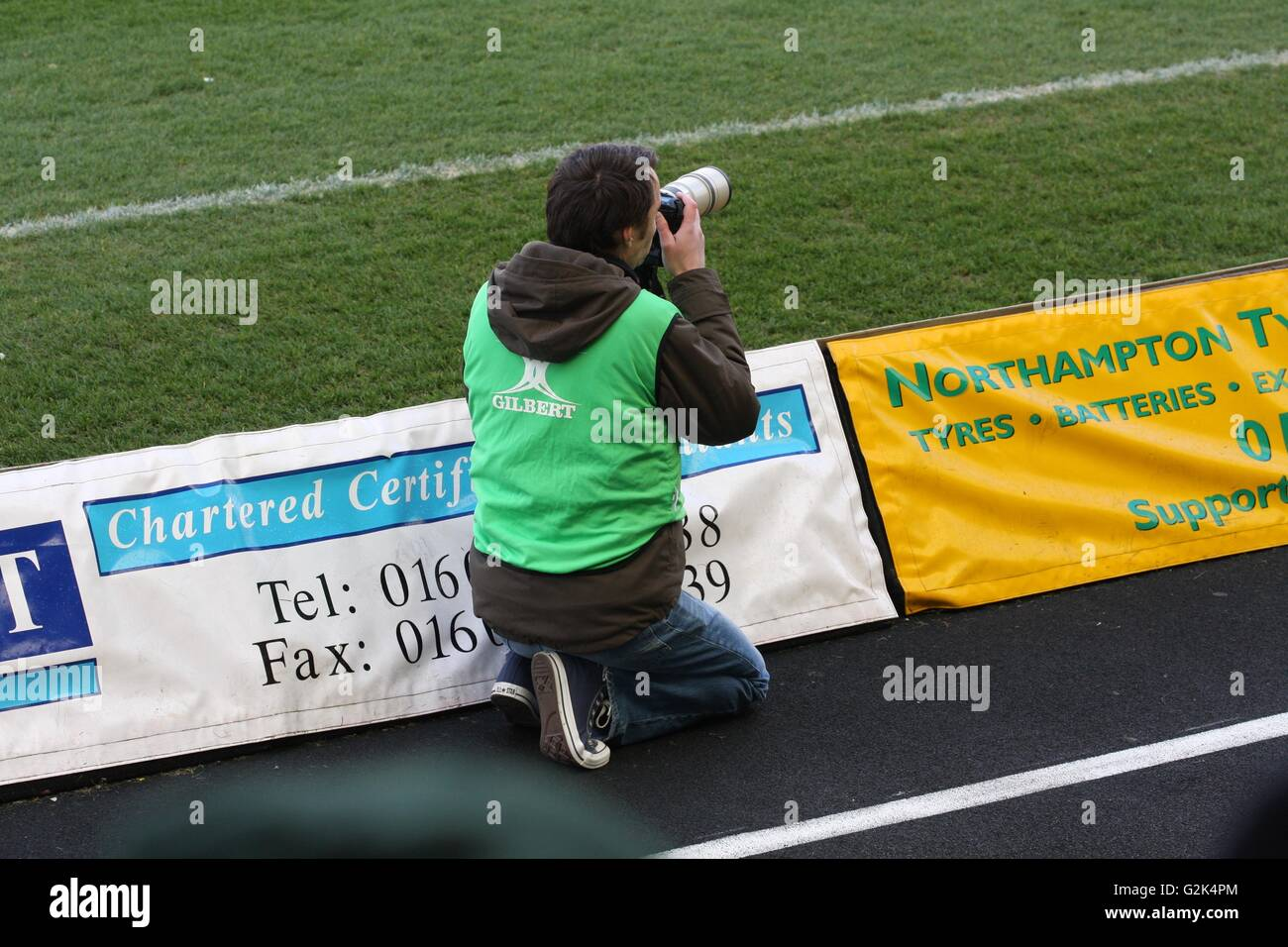 Photographer at a sports event - Stock Image
