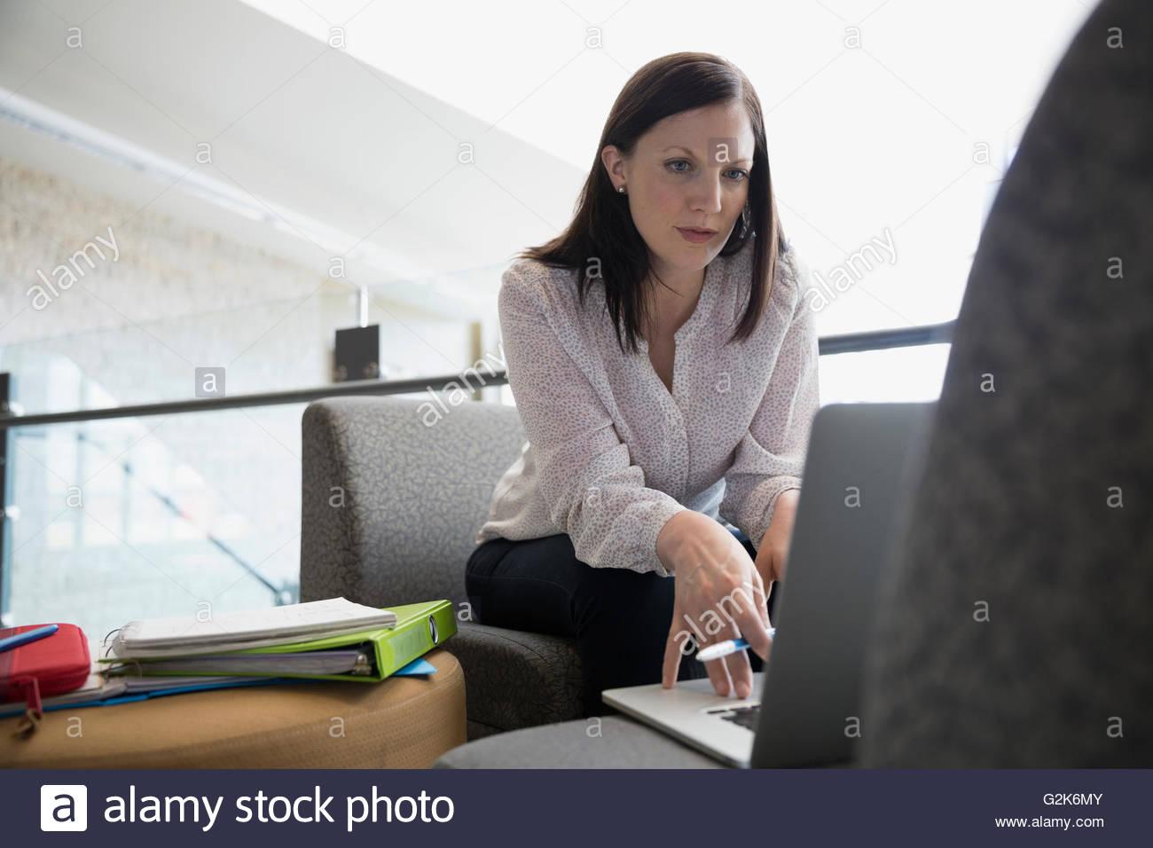 Adult education student using laptop - Stock Image