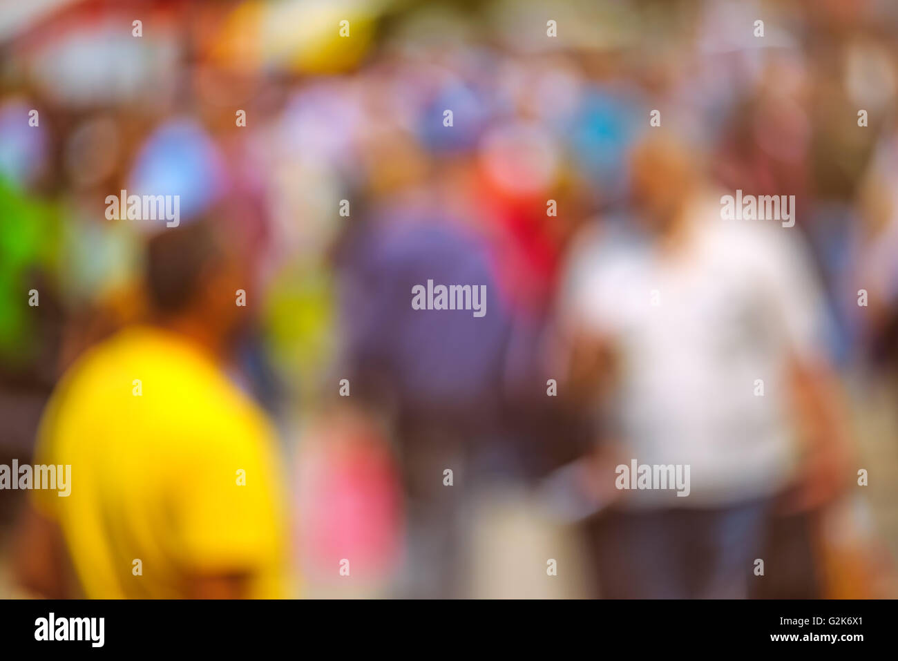 Street crowd out of focus, unrecognizable everyday ordinary men and women as blur urban background. - Stock Image