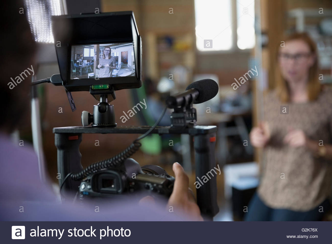 Cameraman filming tutorial - Stock Image