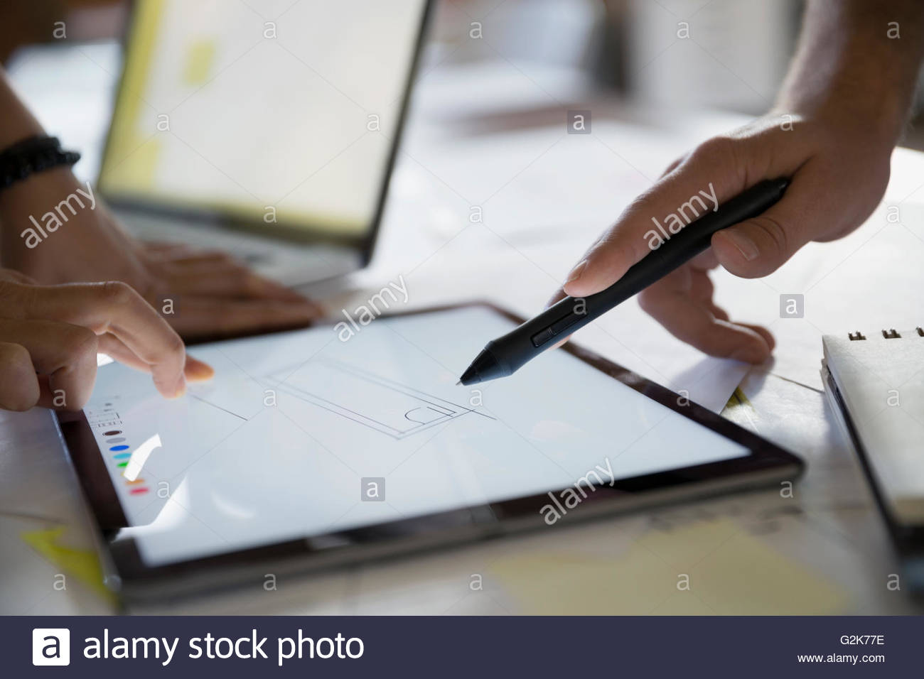 Close up designers drawing on digital tablet - Stock Image