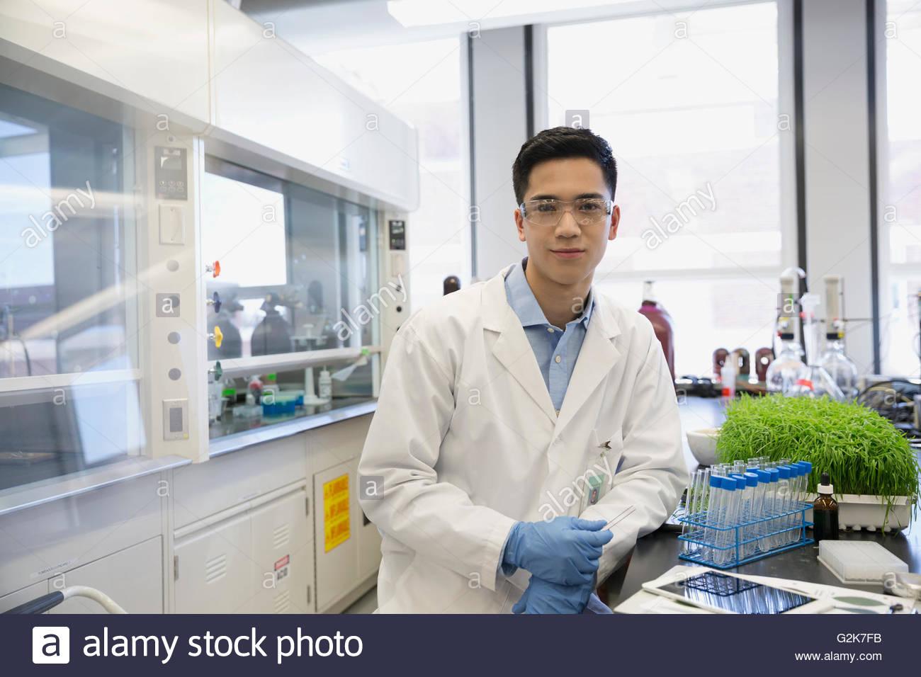 Portrait confident scientist in GMO laboratory - Stock Image