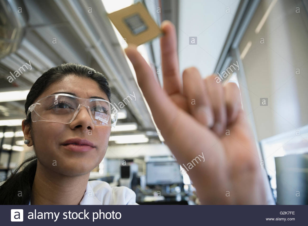 Engineer examining computer chip Stock Photo