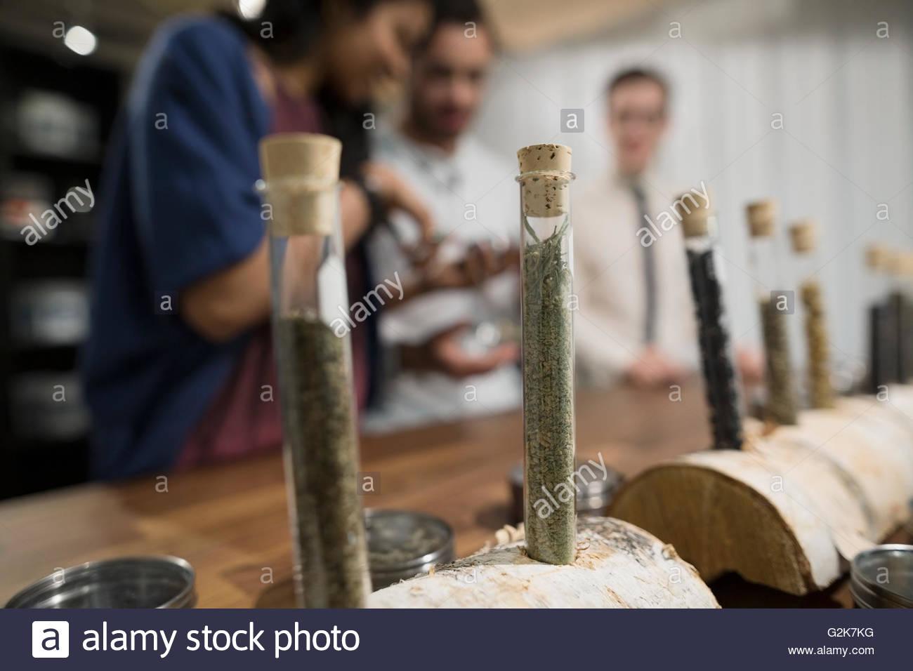 Tea leaves in vials on display in tea shop - Stock Image