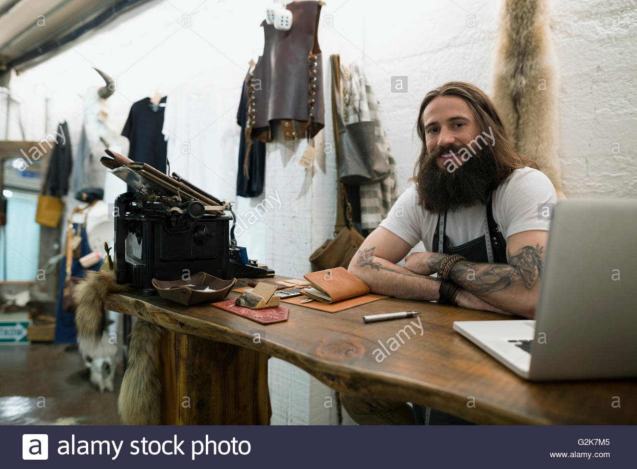 Portrait confident leather shop owner entrepreneur - Stock Image