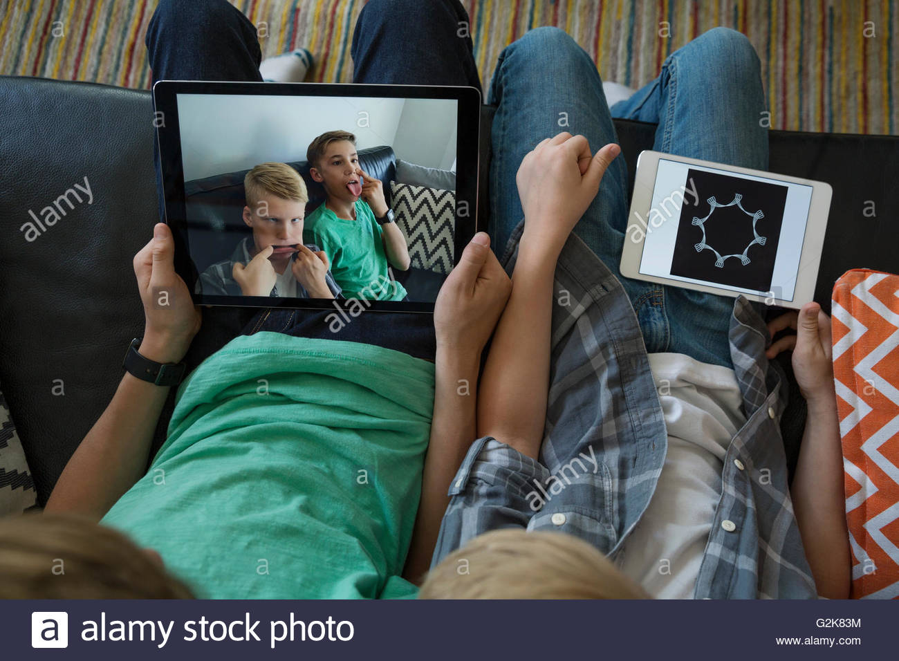 Boys taking silly selfie with digital tablet - Stock Image