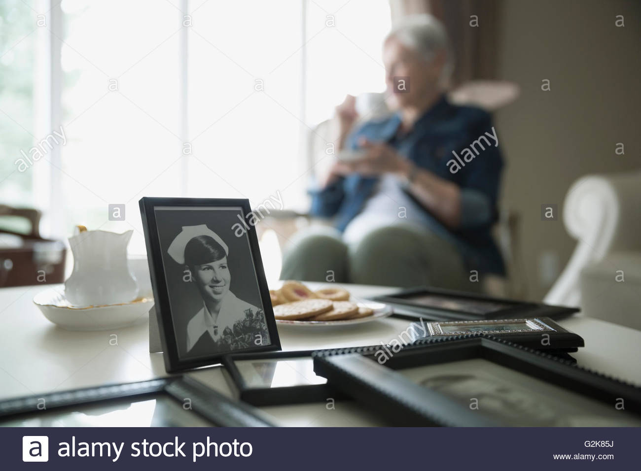 Old photograph of woman with senior woman in background - Stock Image