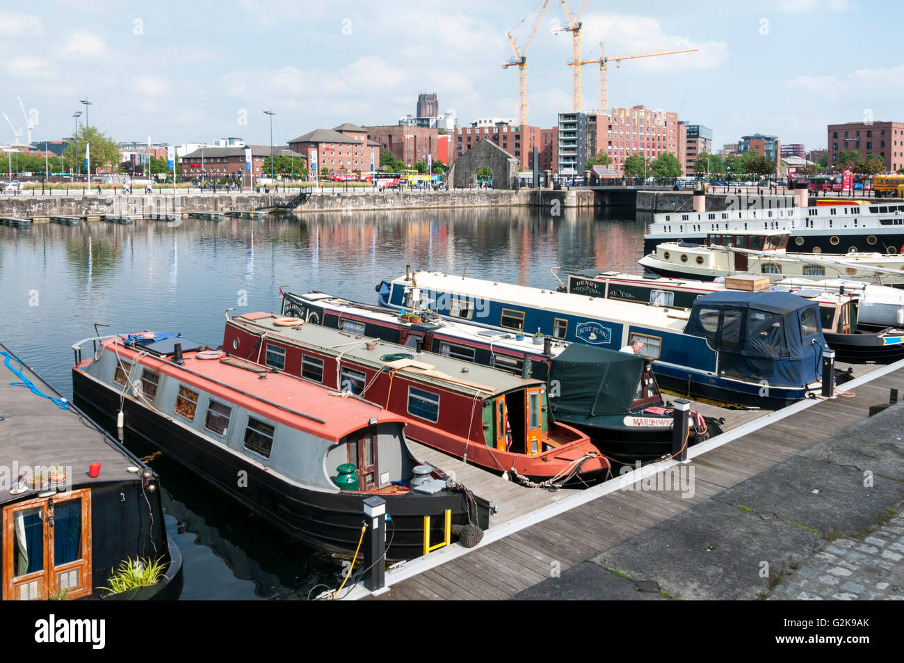 Canal narrowboats moored in the Grade II listed Salthouse Dock, Liverpool. - Stock Image