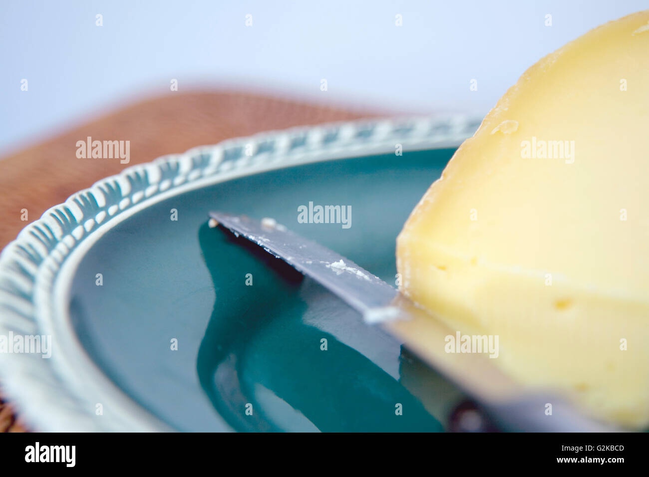 Cheese and a Knife on a Platter - Stock Image