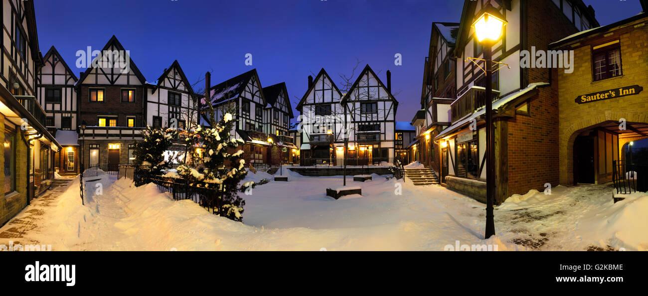 Tudor houses, at night in winter, Pickering Village, Ajax, Durham Region, Ontario, Canada - Stock Image