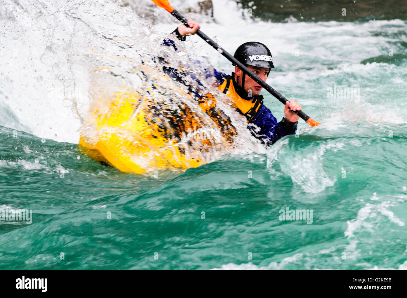 A freestyle kayaker navigates the rapids on the Kananaskis River at the Canoe Meadows course in Alberta - Stock Image