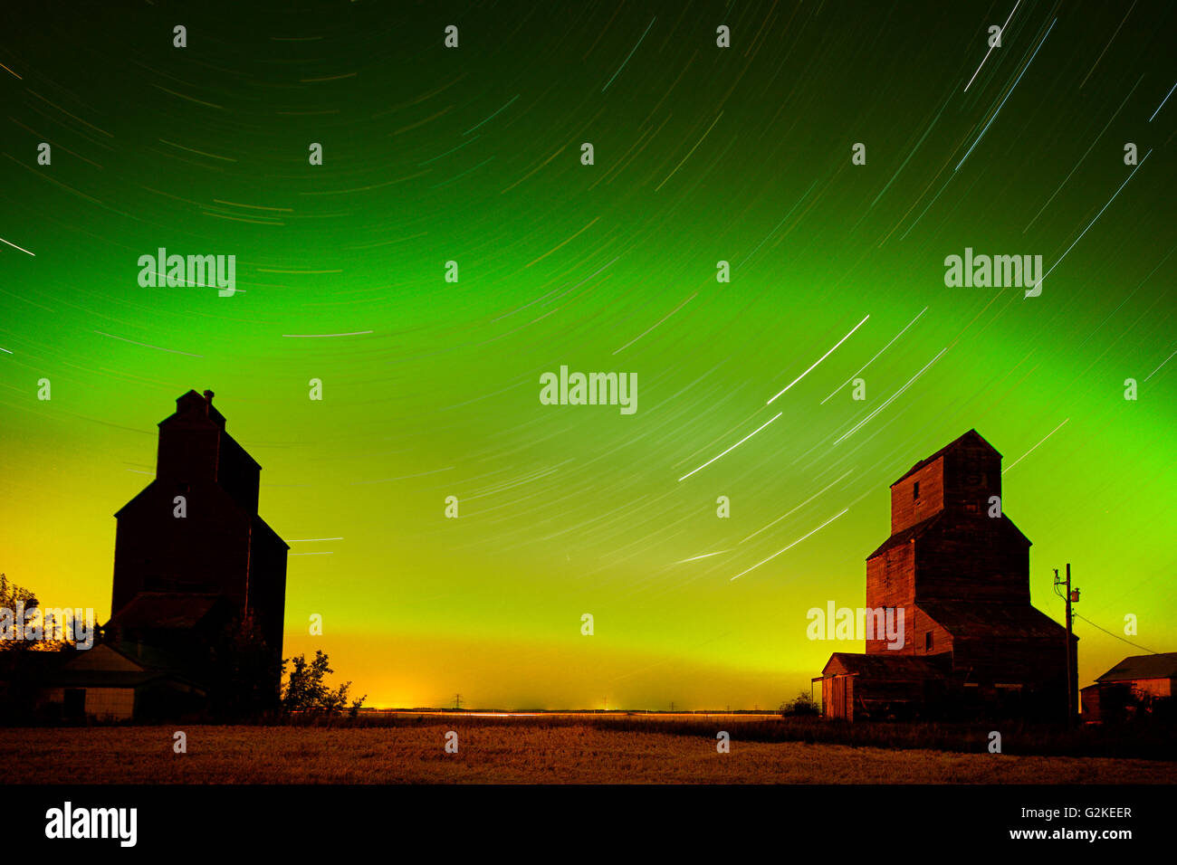 Grain elevator in ghost town with northern lights in the northern sky Lepine Saskatchewan Canada - Stock Image