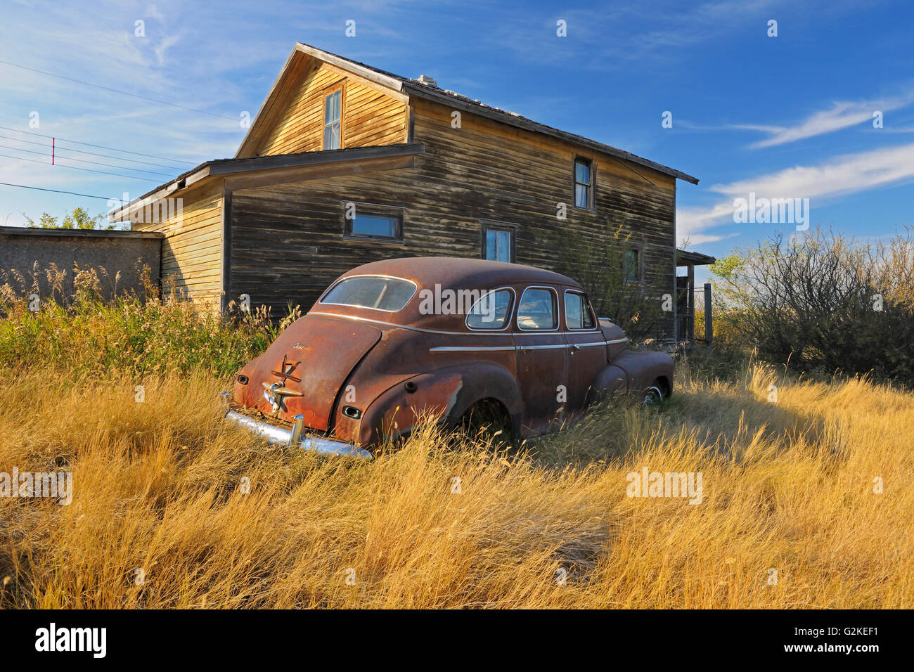Old car and house in ghost town Laverna Saskatchewan Canada - Stock Image