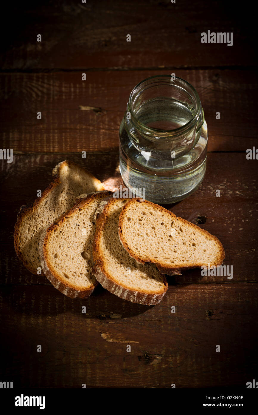 Water, bread, symbol hungry, thirst, suffer - Stock Image