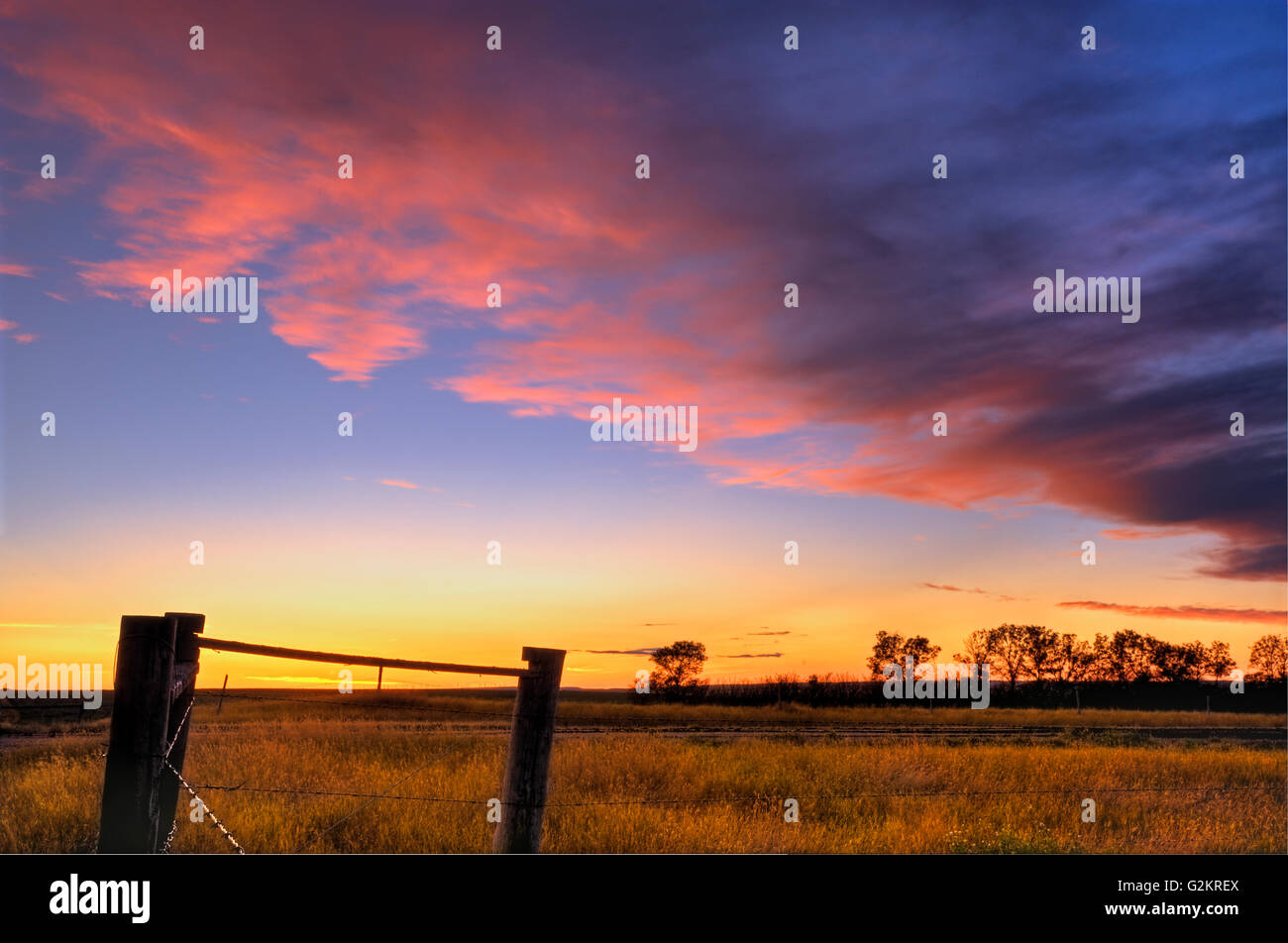 Fence and sunset sky near Braddock Saskatchewan Canada - Stock Image