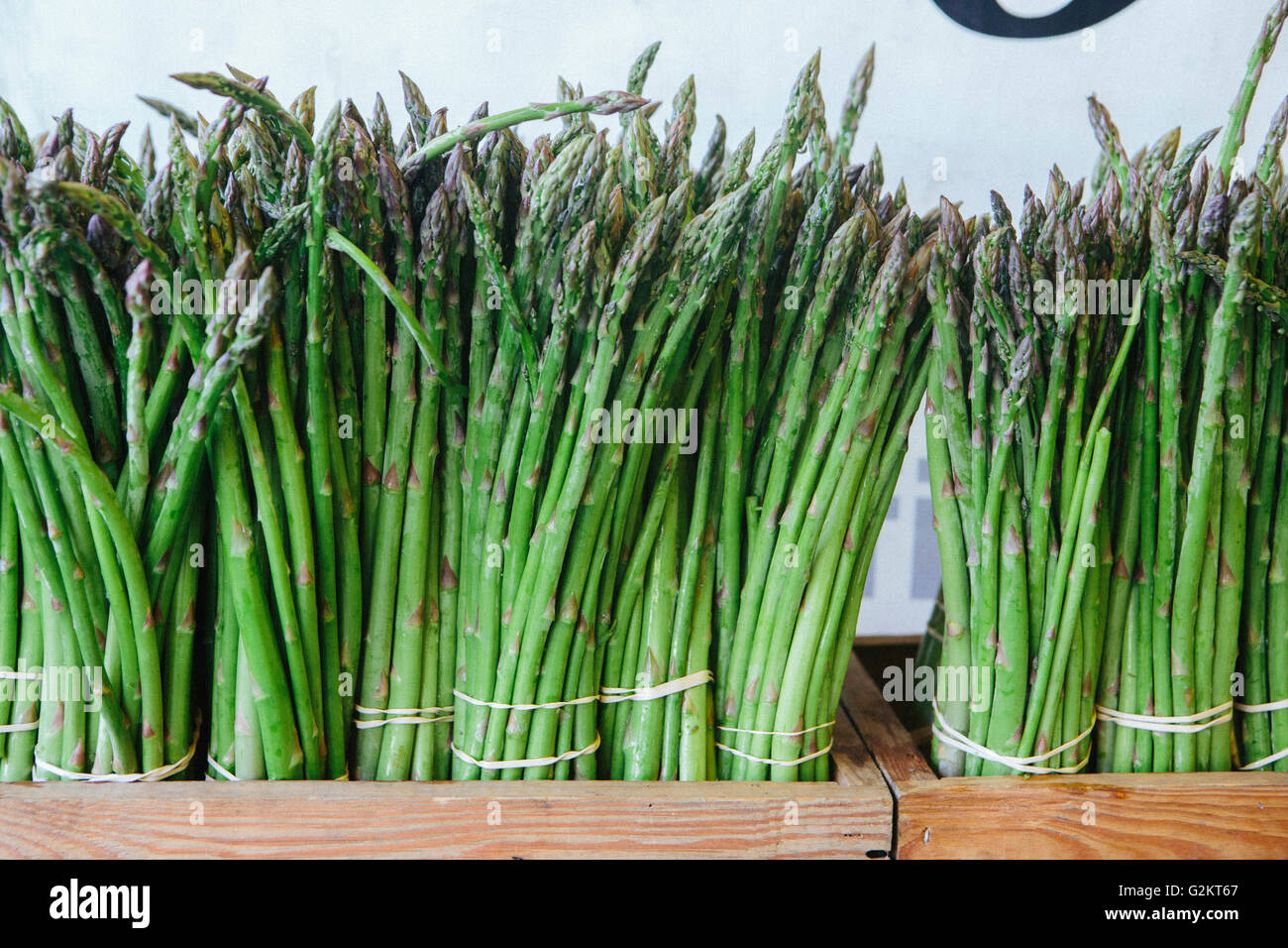 Bunches of Asparagus Sprigs Standing Upright - Stock Image