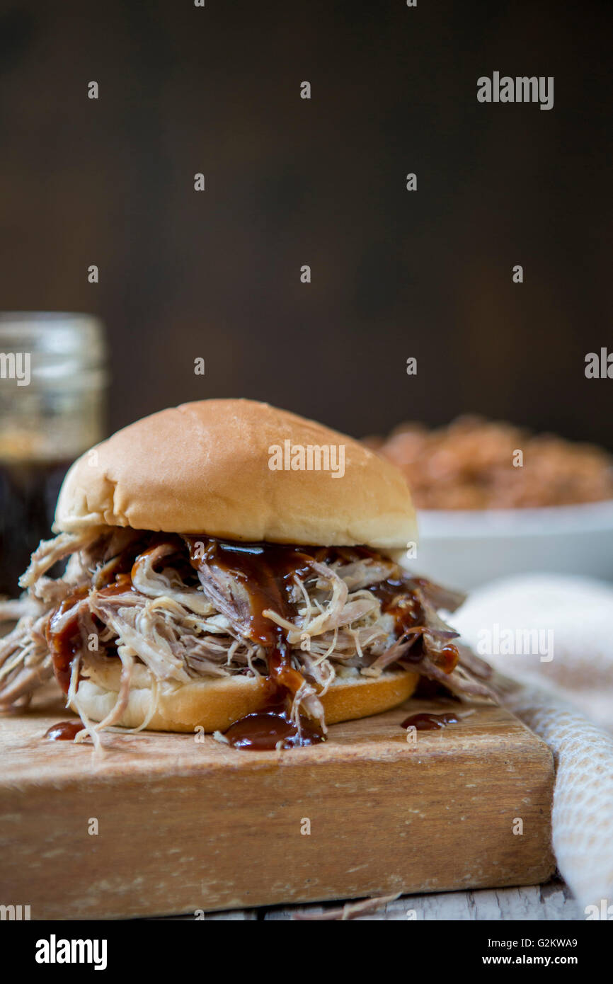 Pulled Pork Sandwich with Barbeque Sauce - Stock Image