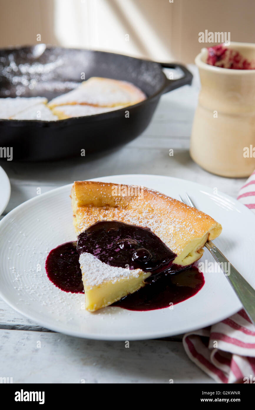 Dutch Pancake with Blueberry Syrup - Stock Image