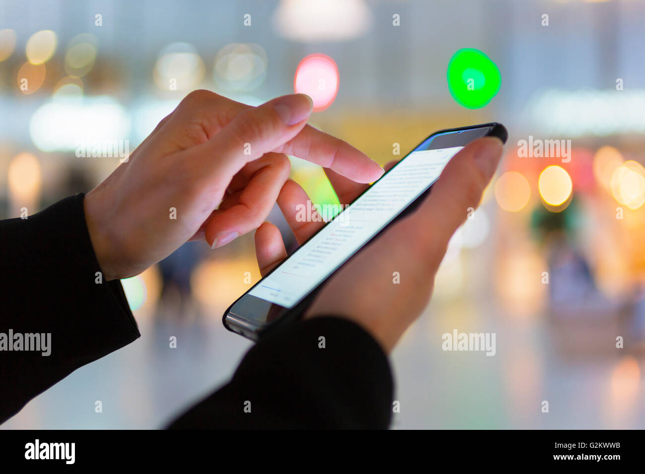 Close up of woman hand text messaging - Stock Image