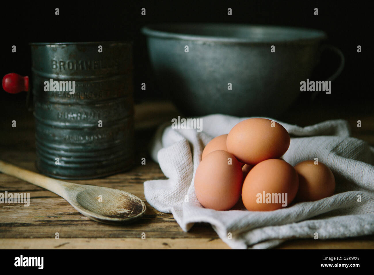 Brown Eggs with Wood Spoon, Sifter and Mixing Bowl - Stock Image