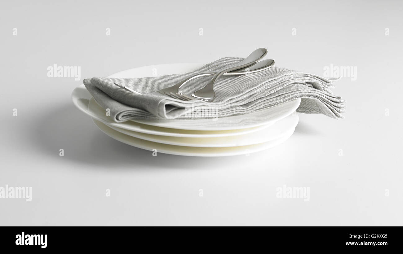 Stack of plates on grey background - Stock Image