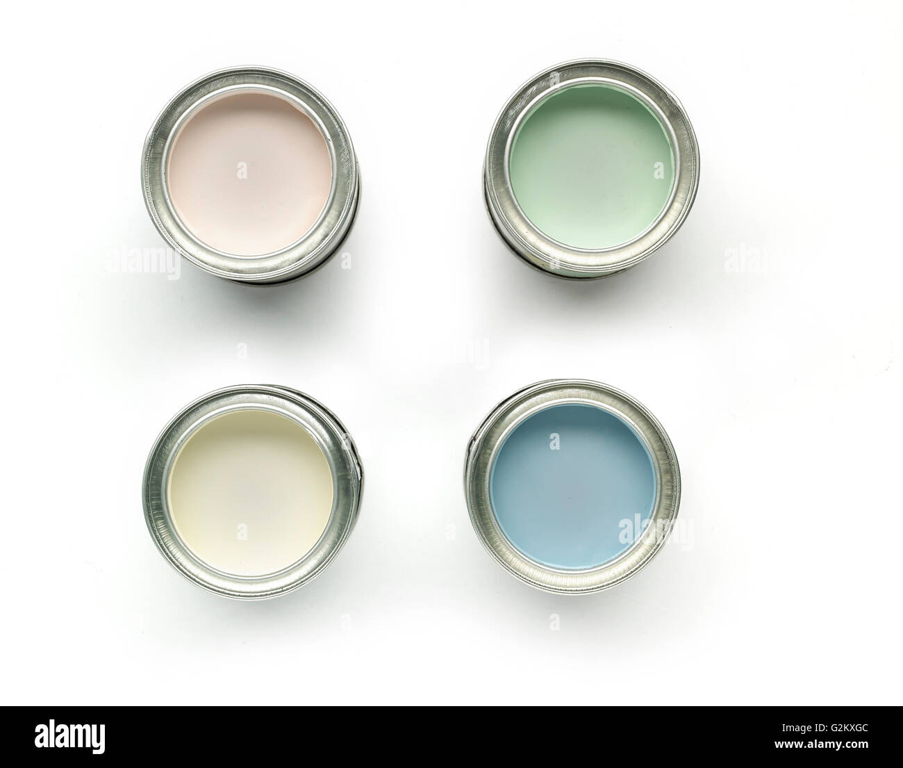 4 paint tins from above - Stock Image