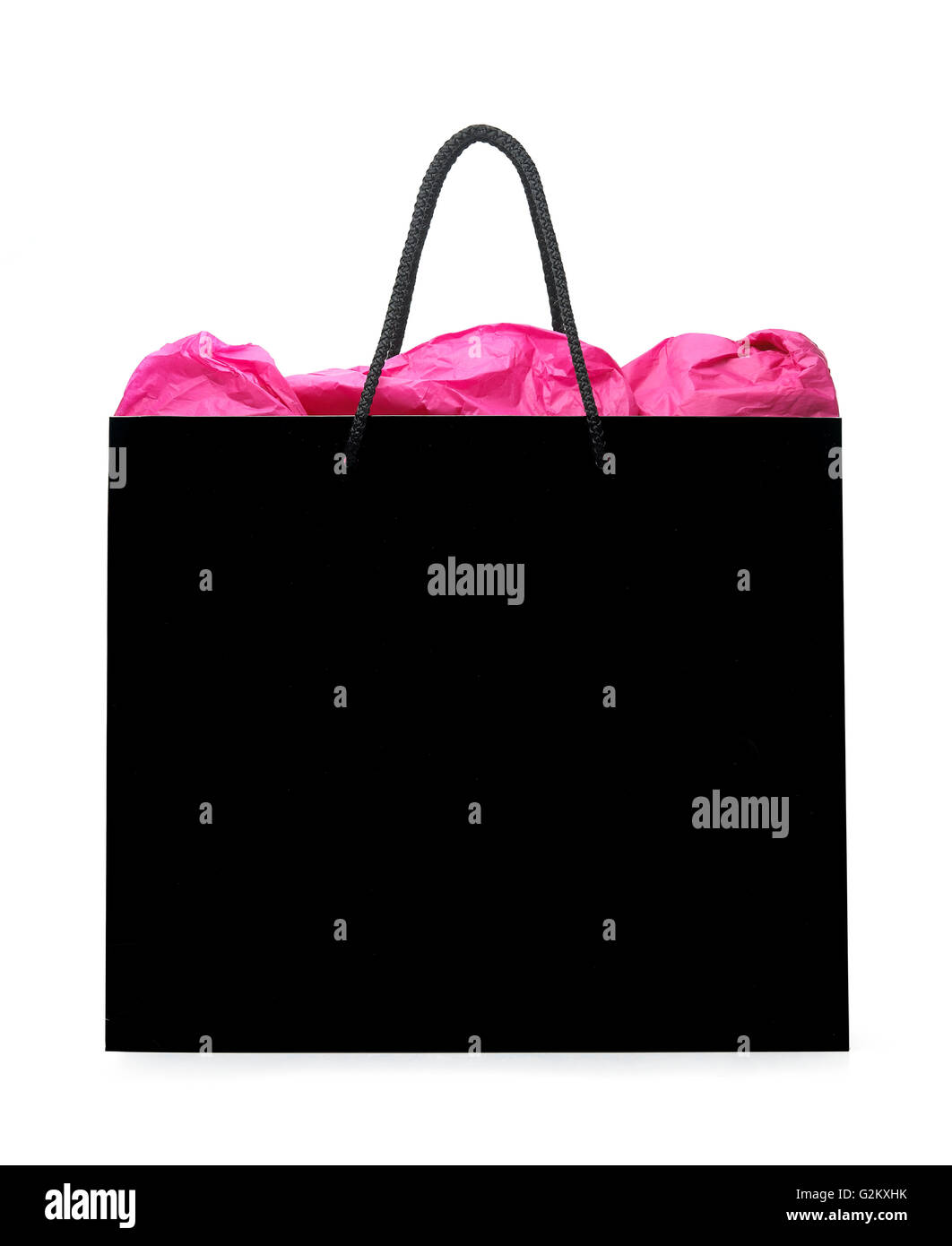 Black shopping bag with pink paper coming out - Stock Image