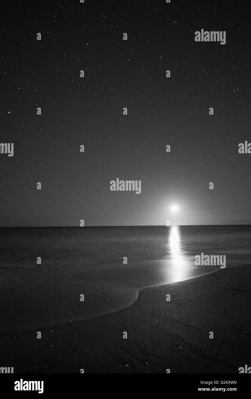 Moonrise Over Ocean at Night, Vero Beach, Florida, USA - Stock Image