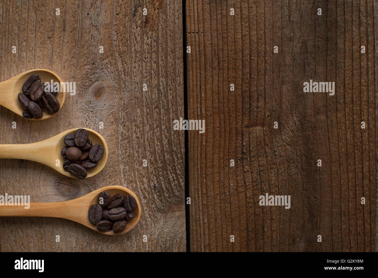 coffee bean Spoon on a wooden table - Stock Image